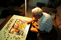 Elderly Man and Puzzle